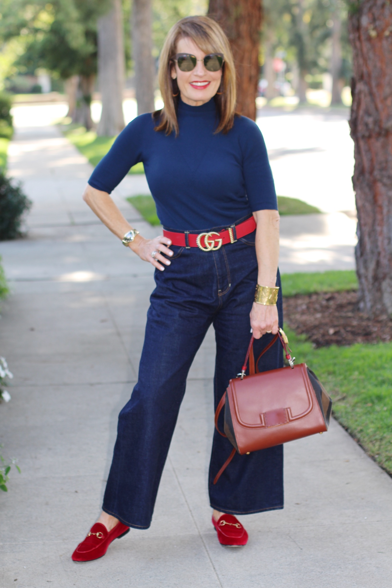 A World Curated sweater   , Fig London Jeans    similar here   ,    Gucci belt    and    loafers   , Fendi handbag,    Hamilton watch   , and    in silver here   , vintage YSL cuff,    Mykita shades