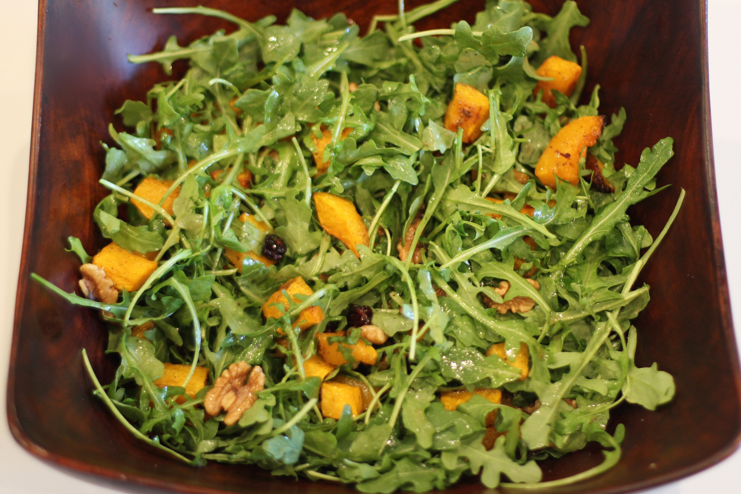 Talk about a multi tasking salad! This one is loaded with all things good and nutritious; from beta carotene, (among other important nutrients), packed butternut squash, to Omega 3 loaded walnuts. Arugula, which is a super food, is loaded with Vitamins A, C and folate, and provides 100% of your daily Vitamin K intake, which is important for blood clotting.