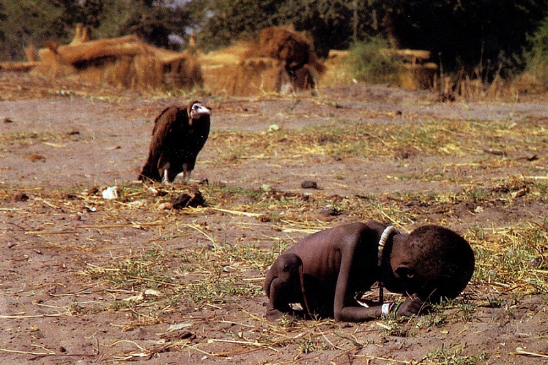 "A 1994 Pulitzer Prize wining photograph by journalistic photographer Kevin Carter during the Sudan famine.  The photo depicts a child struggling towards a United Nations food camp a mile away, as a vulture is waiting for the child to die.  No one knows what happened to the child.   Two years later, Kevin committed suicide, saying   ""I am haunted by the vivid memories of killings and corpses and anger and pain ... of starving or wounded children, of trigger-happy madmen, of killer executioners"".   Whether or not he did the wrong thing when photographing the struggling girl in Sudan, the truth is that Kevin Carter gave his whole life for the sake of information. He communicated reality in the most truthful way, hoping to make a change by increasing society's awareness of the world's injustice.    Read the story behind this controversial image here."