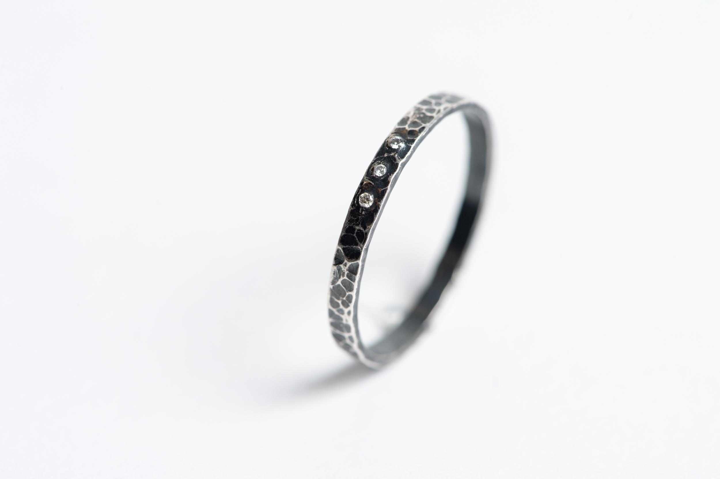 Sterling Silver, Diamond.