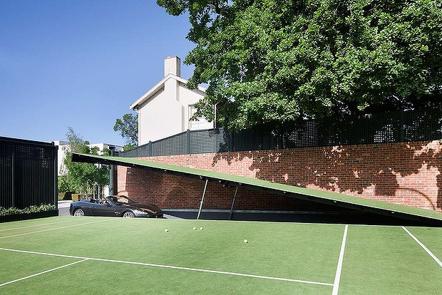 Amazing Designs: Astonishing design hidden from view in Toorak. A section of the tennis court raises to reveal a ramp to the underground car park.
