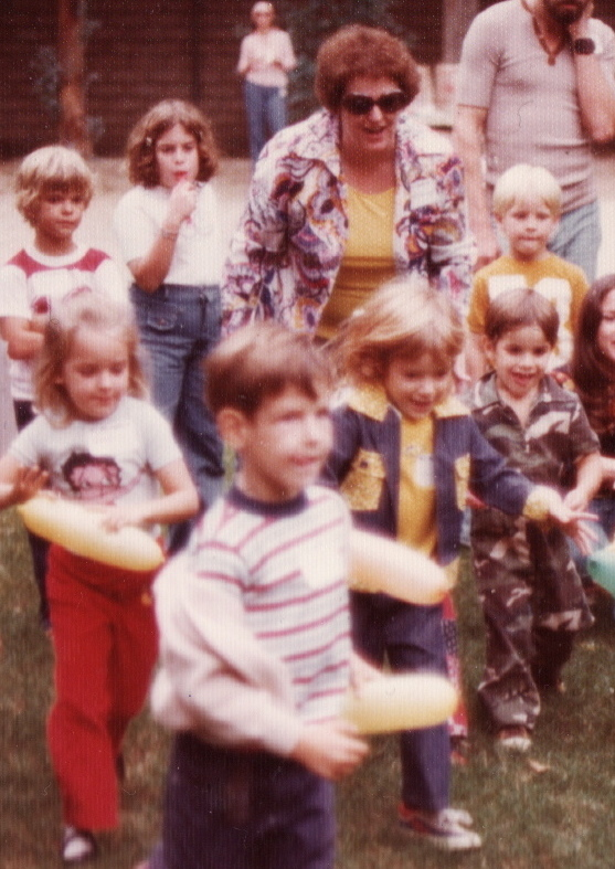 Samantha and I at our second school picnic... her mother Dee cheering us on in the background- 1976