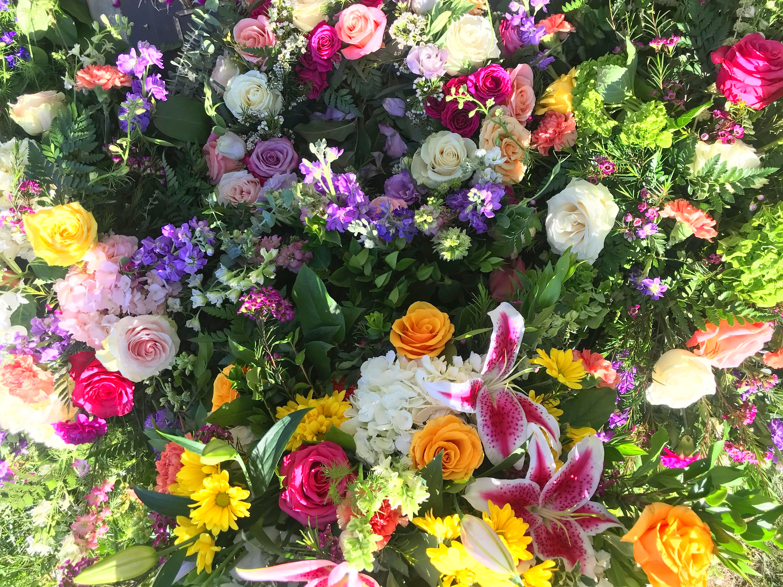 Flowers covering Jan's grave site after her burial - May 3, 2019