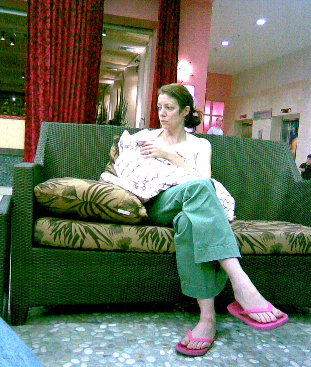 Public nursing challenges at the Mall - Me with my ten-month-old daughter - Nov. 23, 2007