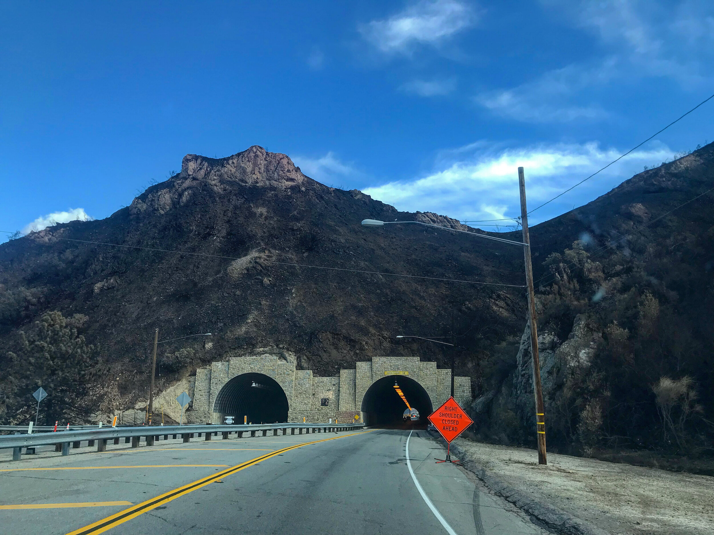 November 22, 2108 - Kanan Road Tunnels surrounded by black and burned mountains (📷: Lisa Butala Zabaldo)