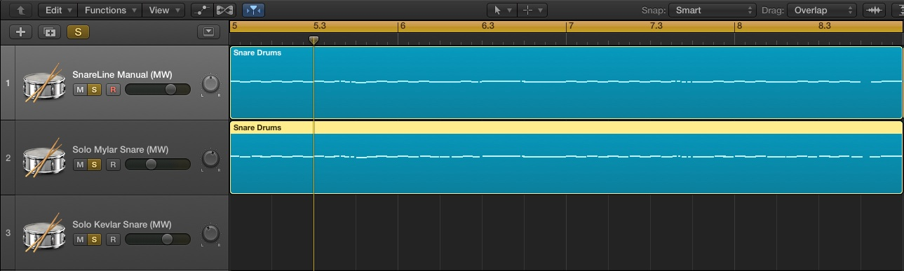 Two blue regionsshows identical MIDI data copied from first track into second track set to use the Solo Mylar Snare patch from Virtual Drumline.