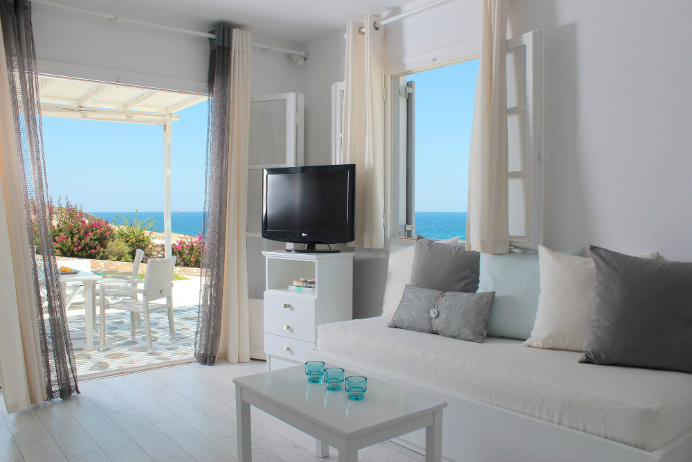 Luxury Hotel Paros Minois living room interior sea view.jpg