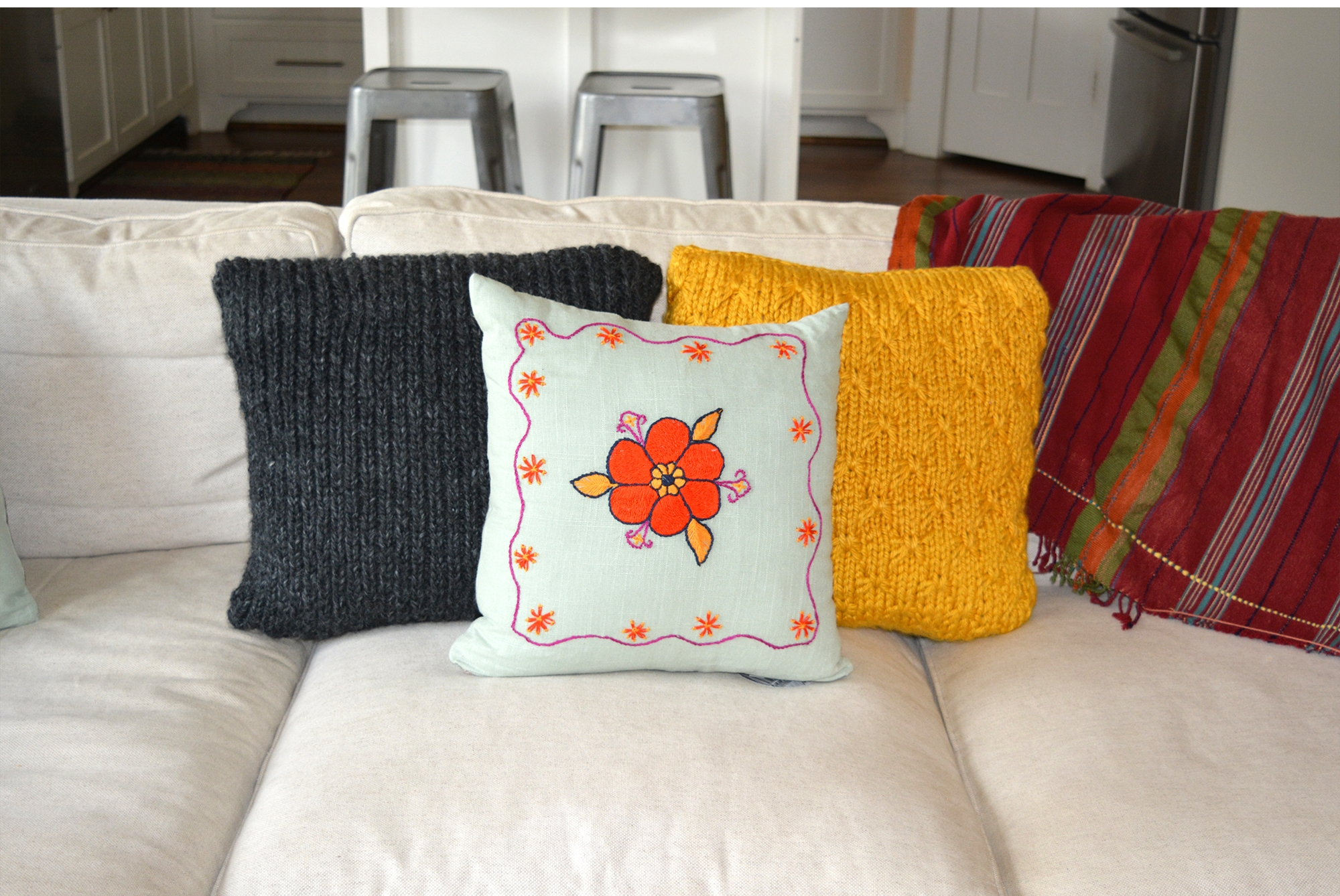 knit and embroidered pillows on couch for web.jpg