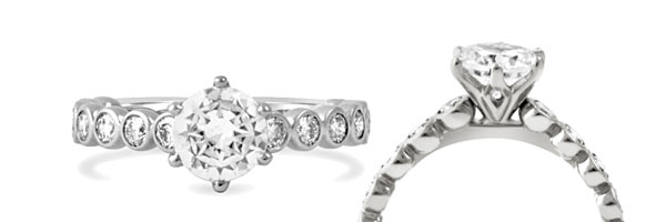 Unique yet timeless our Becoming engagement ring features a row of bezel set diamonds and a tulip-inspired center crown.
