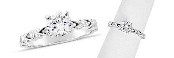 Be lucky in love with this beautiful engagement ring featuring a uniquely designed thin diamond band.