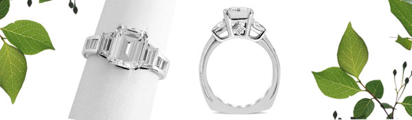 Be blissfully wedded with this timeless emerald cut three stone ring. Baguette side diamonds add elegance and beauty to this heirloom piece.