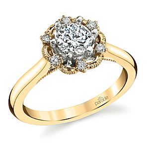 2. Scattered diamonds set into an open halo form this stunning vintage-inspired engagement ring.