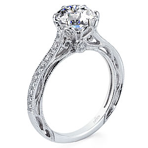 3. A thin diamond band and open-work design make this engagement ring beautiful and unique.