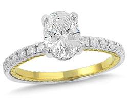 13. A unique twisted rope design and thin diamond band accentuate the oval diamond of your choice.
