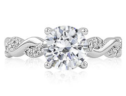 1. Our Heartfelt engagement ring features intertwining bands of metal and gleaming pavé set diamonds.