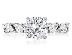 3. Pear shape diamonds add intrigue and beauty to this classic style engagement ring.