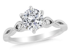 2. A delicate infinity band captivates the simplistic style of our Rejuvinate engagement ring.