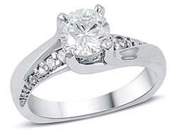 4. Cascading graduating diamonds and a subtle twist make our Intriguing engagement ring beautiful and unique.