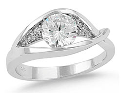 8. Clarity's curving lines and asymmetrical beauty form this alluring engagement ring.