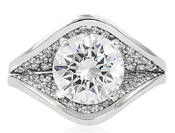 7. This stunning wide and sculptural engagement ring is perfect for the modern bride.