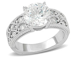 6. Intricately designed with milgrain detailing this stunning vintage-inspired engagement ring is sure to impress.