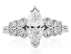 12. Flourishing diamond petals cascade up this two-tone engagement ring.