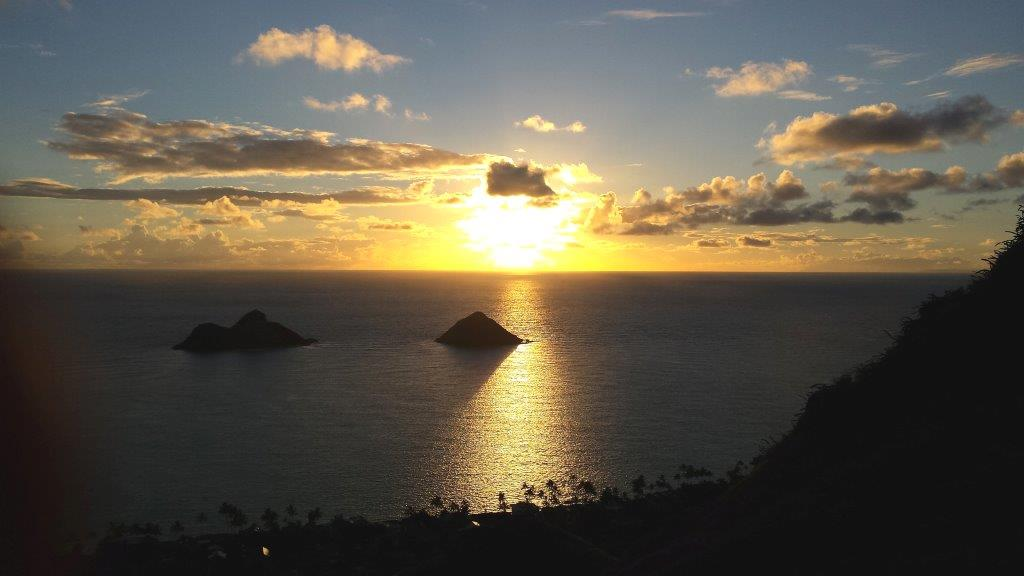 This is the sun-rise vista on top of the Lanikai Hike (an easy to average hike) on the windward side of Oahu near the town of Kailua. The two large rocks you see are called the Mokuluas and are remnants of a 3.8 million year old volcano. If you are an early riser, we can make this wonderful experience a part of your tour. Be sure to wear hiking boots or good cross-trainer style shoes for safety.  Or, if you prefer, we can take you on an easy hike to a waterfall and pool in the rainforest as well or an easier hike to Oahu's East end lighthouse. It is a paved hike all the way and even wheel chair friendly.