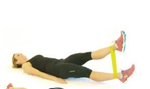 A great, quad strengthening exercise where you lay on the floor with your legs in your fitness loop. Keep one leg on the floor while you pulse the other leg up, working your quadriceps one at at time