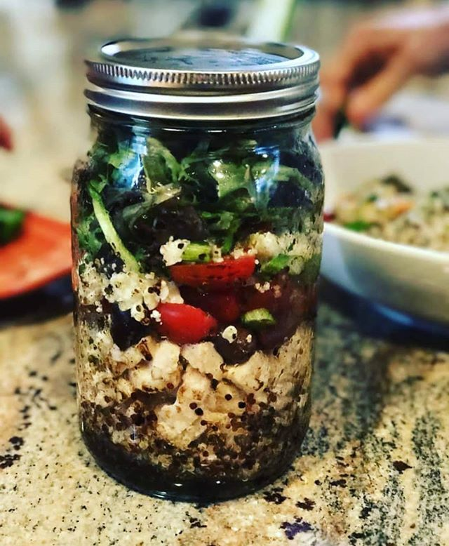 📣 BACK TO YOU CHALLENGE - DAY 5 We all lead busy lives with so much demanding of our time and why it's so important to have a plan and be prepared to live a healthy lifestyle. Prepping salads in Mason jars is a great, fun way to prepare healthy meals in advance and grab out of the fridge. Being busy doesn't have to derail your nutritional goals! There are endless options when you pull together your favorite greens, herbs, nuts and veggies. Give this recipe a try and see if it doesn't make eating healthier easier 🙌 .. 1.5 tbsp olive oil 1.5 tbsp balsamic vinegar 1 tbsp Dijon mustard 1/2 tsp dried oregano salt and pepper to taste 1/2 cup quinoa (cook according to package and bring to room) 1/2 cup cooked chicken 1/2 cup diced red peppers 1/2 cup diced tomatoes 1 tbsp diced Kalamata olives 1/2 cup sliced cucumbers 1 cup mixed green (arugula, baby spinach & chard) 1 tblsp crumbled feta cheese .. Directions: In a large mason jar add oil, vinegar, mustard, oregano, salt and pepper first, then quinoa, chicken, peppers, tomatoes, olives, cucumber, greens and then cheese. (The order of the ingredients is important to keep greens from getting soggy.) Store in fridge with lid. When ready to eat, shake to mix dressing and pour onto your favorite dish. .. 📌 To participate in today's challenge, share one of your favorite on the go healthy snacks 👇