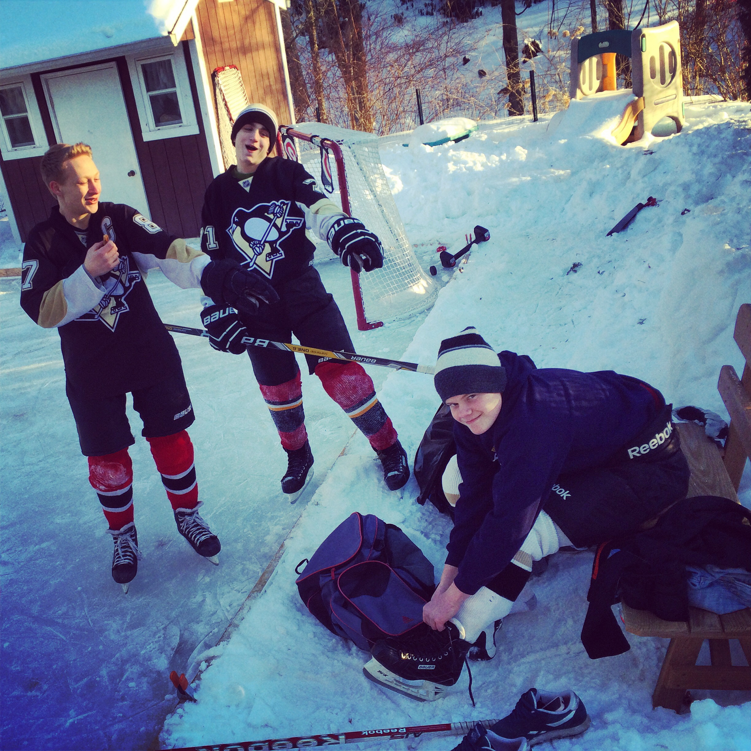 A few of my jr. high hockey players getting ready to play out back.