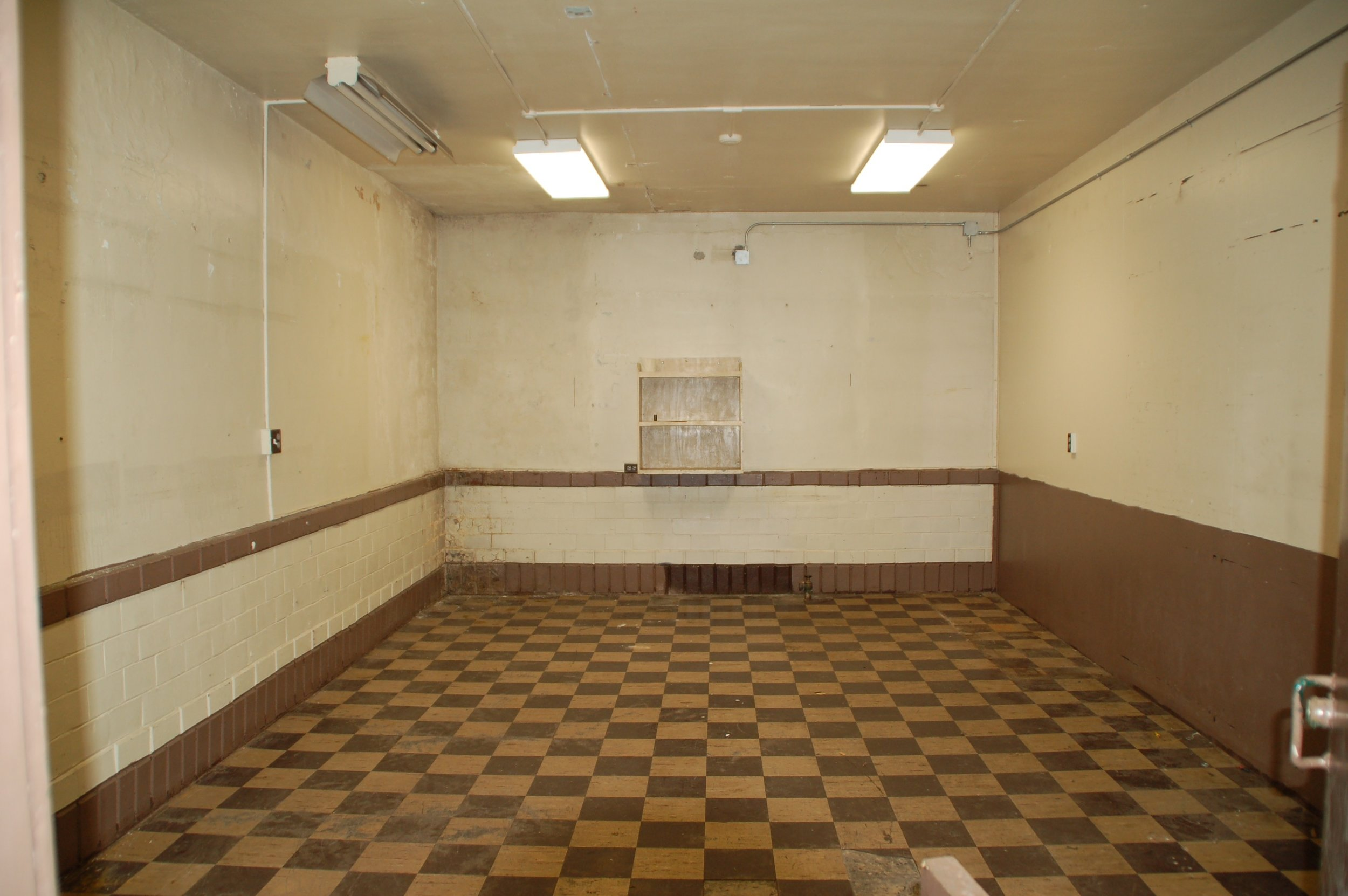 A wall will be taken out between this office and another to create a larger room for meetings and classroom-like instruction.