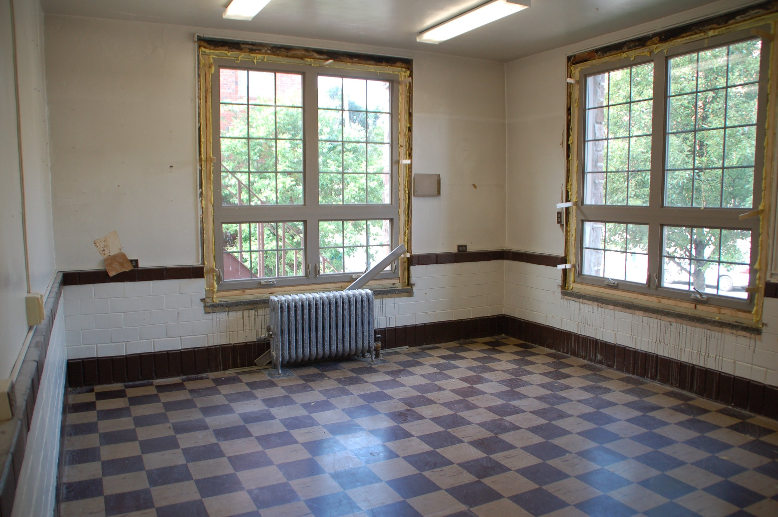 This is the other room that will join the previous picture to create a larger meeting space once we take out the wall.
