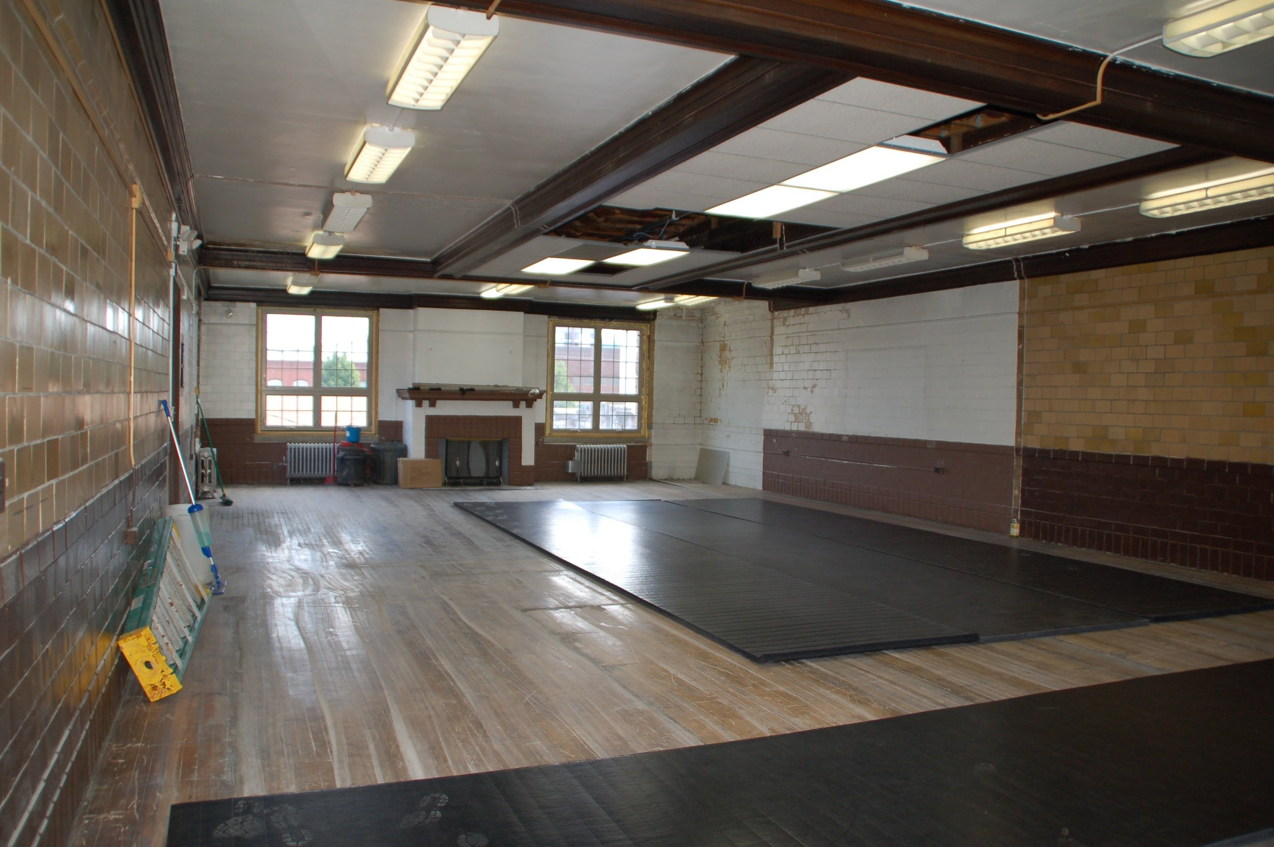 View of the 2nd floor room. We envision this as a rec room/studio and a space for larger gatherings/meetings. The beams and fireplace in this room are gorgeous and we intend to restore them to their original beauty.