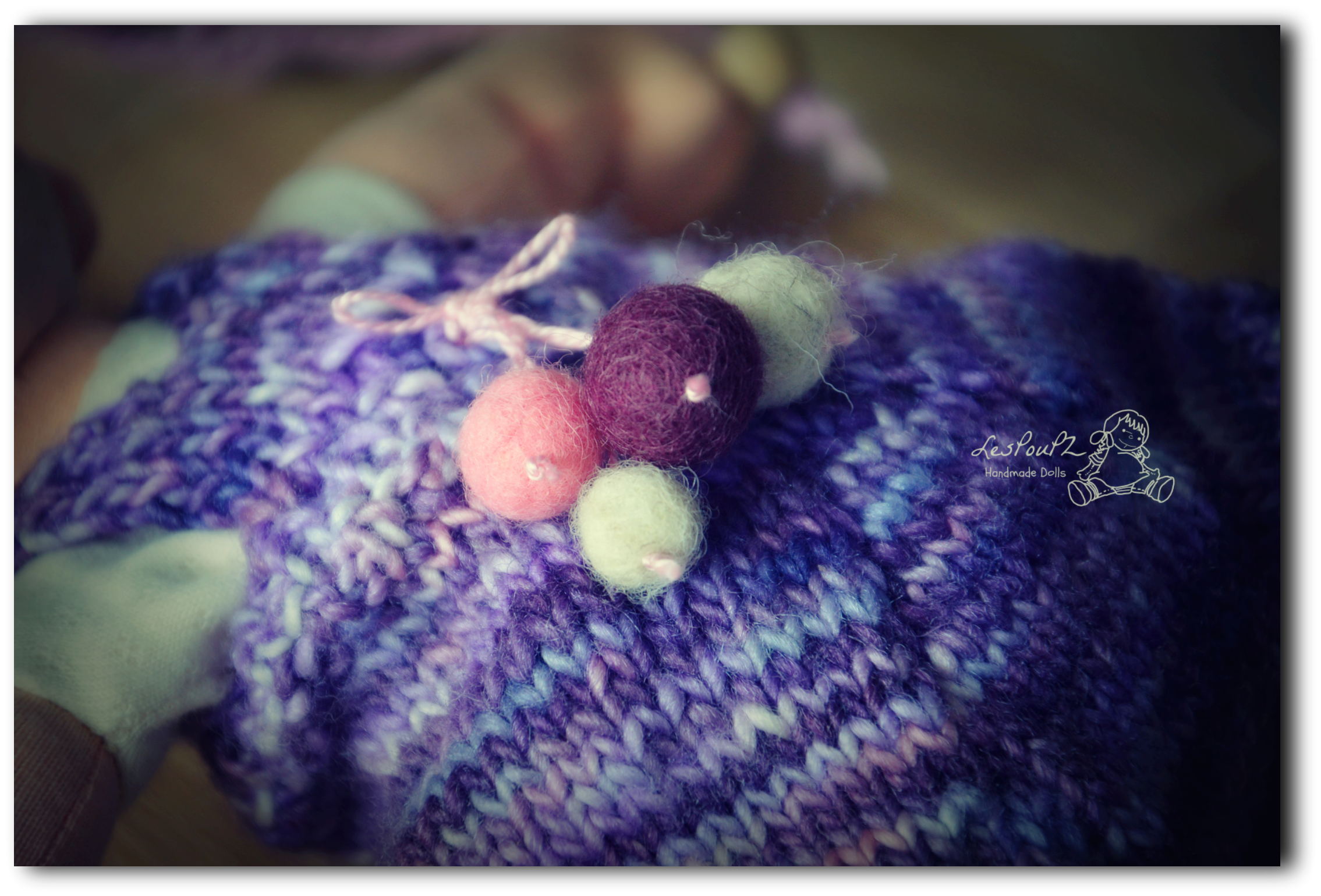 I also hand felted the little dangling balls of her overalls.