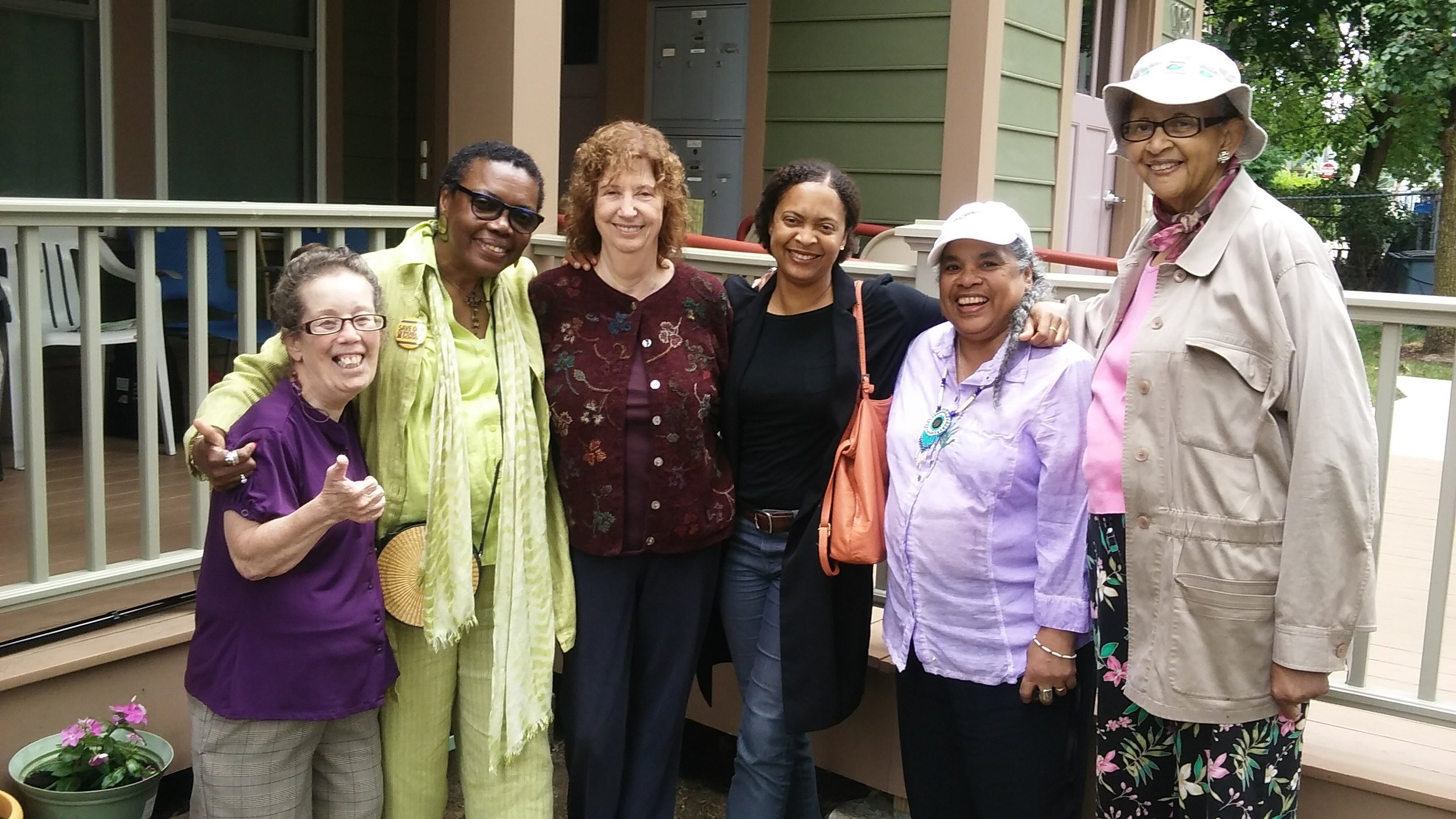 "Courtesy Photo | Some workshop poets celebrate after their well-attended Jamaica Plain Porchfest performance in July, 2016. Left to right: poet Betsaida Gutierrez, whose porch was their ""stage;"" Gloria Johnson; workshop leader Sandra Storey; workshop founder and Poet Laureate of Boston Danielle Legros Georges; Cecelia Estrada Vaughan; and Gwen Lewis."