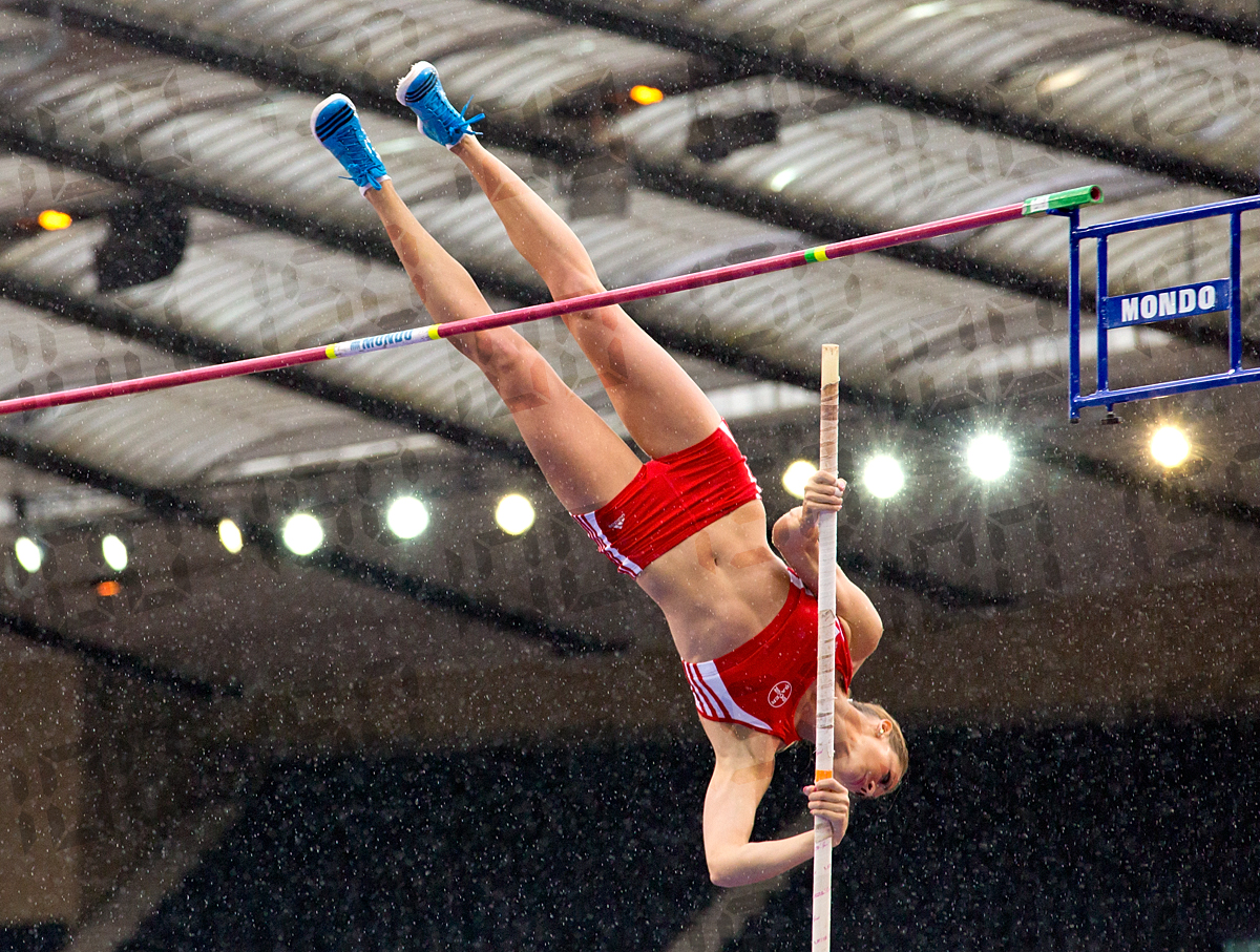Katharina Bauer of Germany does her best to pole vault in heavy rain.