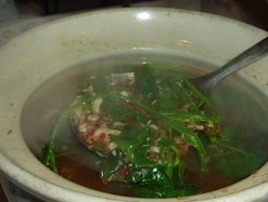 Ant Egg Soup with seasonal local vegetables. You can see all the white eggs over the spoon!