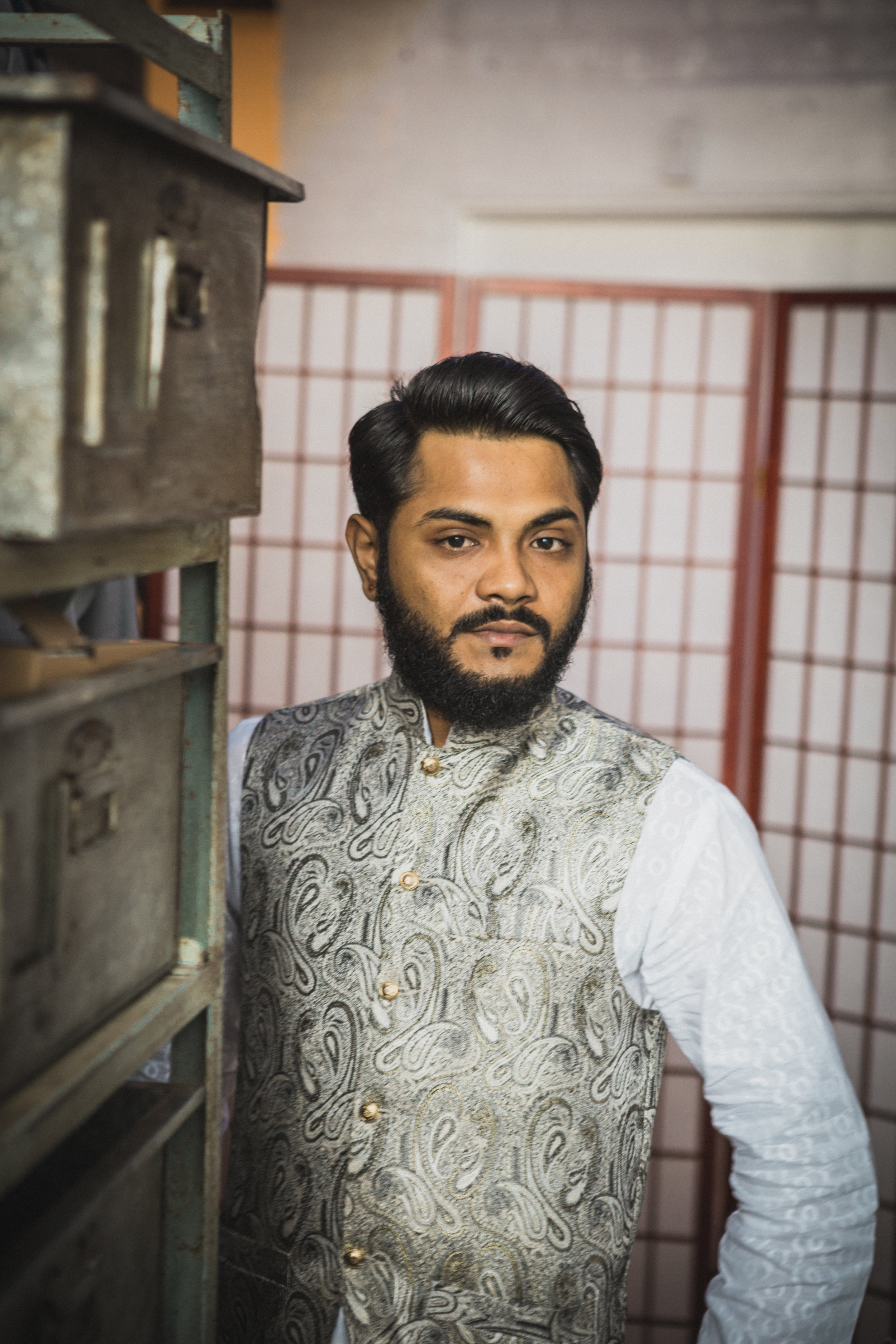 A groom poses in Malaysian vest at Trigger wedding venue in Chicago - Amy Stallard Photography