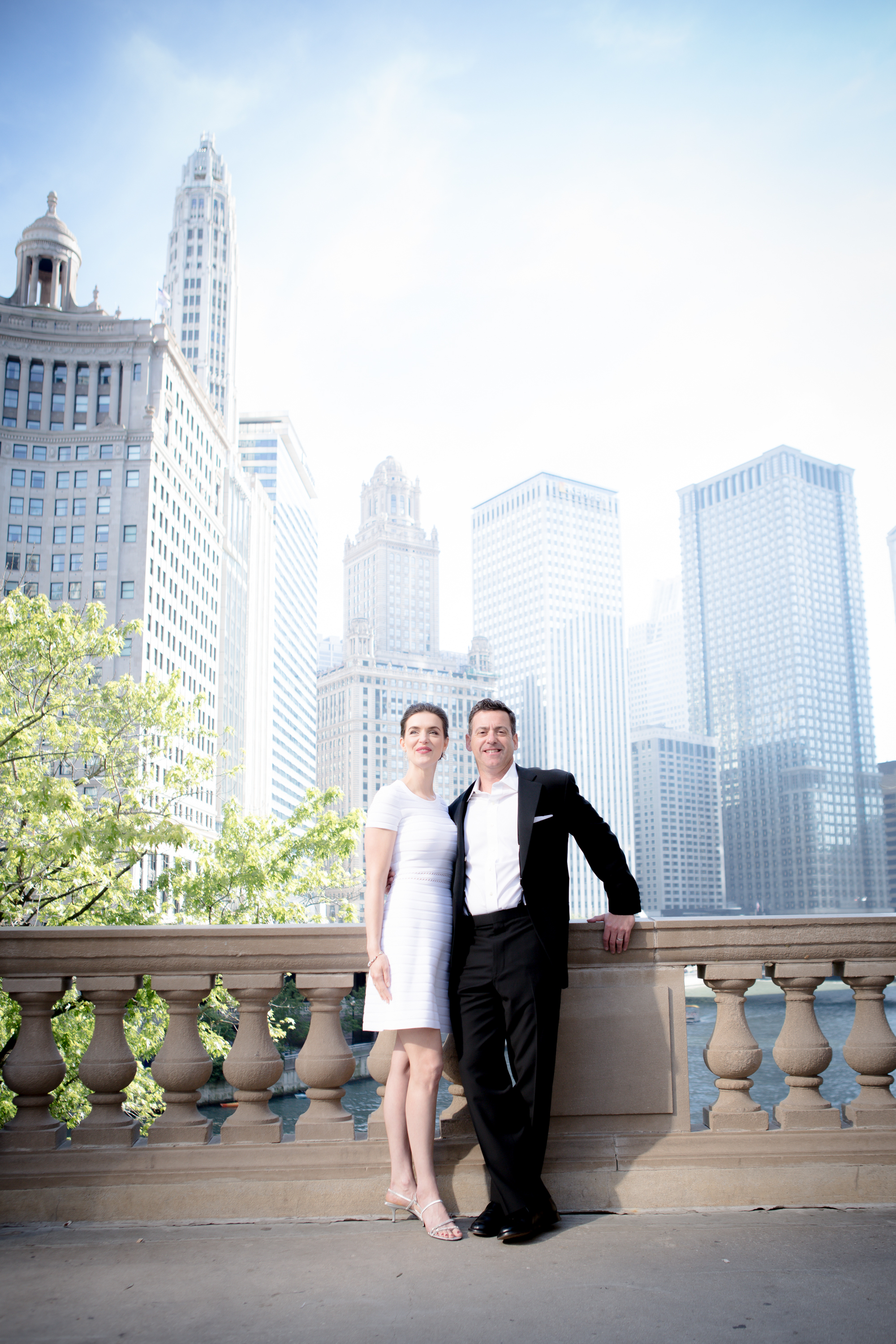 A couple shines on Michigan Avenue in front of the Wrigley Building - Chicago Wedding Photography - Amy Stallard Photography