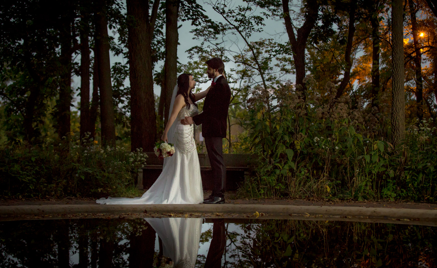 A bride and groom pose at sunset at The Grove at Redfield Estate in Glenview, IL. Chicago Wedding Photography - Amy Stallard Photography