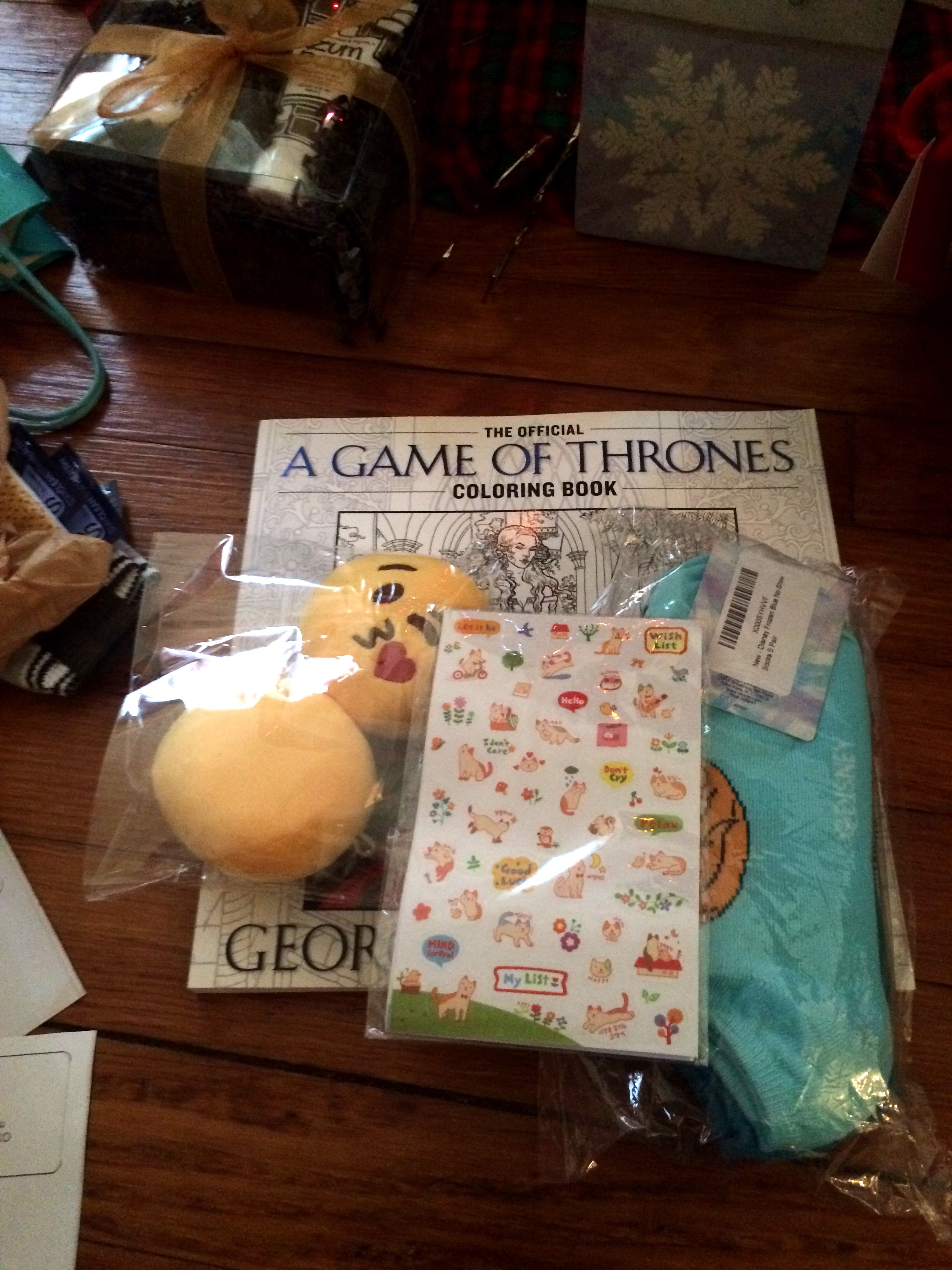 """My bffl sent me gifts for my """"inner child,"""" haha. Cat stickers, Frozen socks, GoT coloring book, and emoji keychains ftw!"""