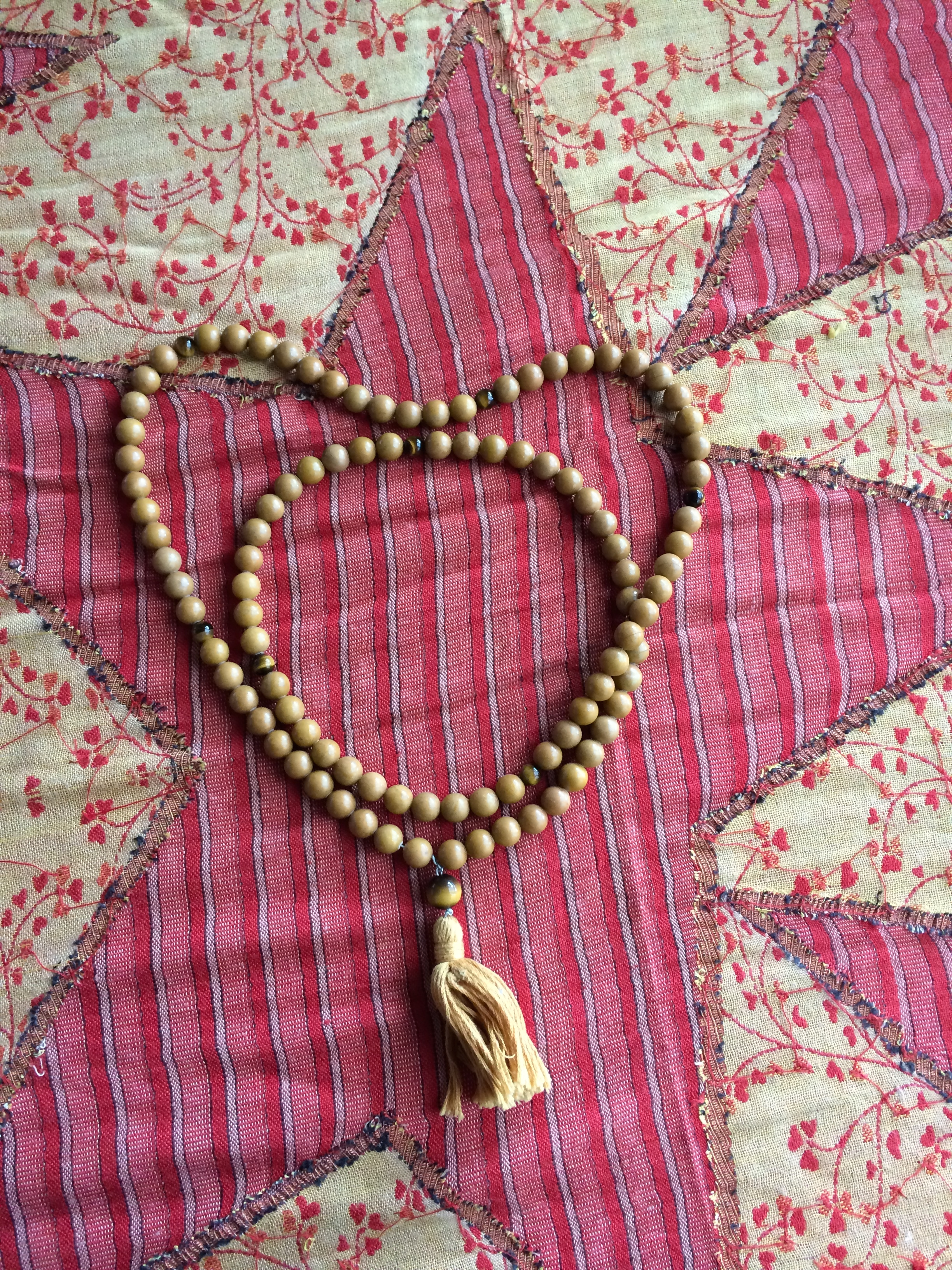 These beautiful japa mala beads are yellow jade and tigers eye - as worn by Buddhist monks  - a gift to Min from Rick and Lindy Butler.