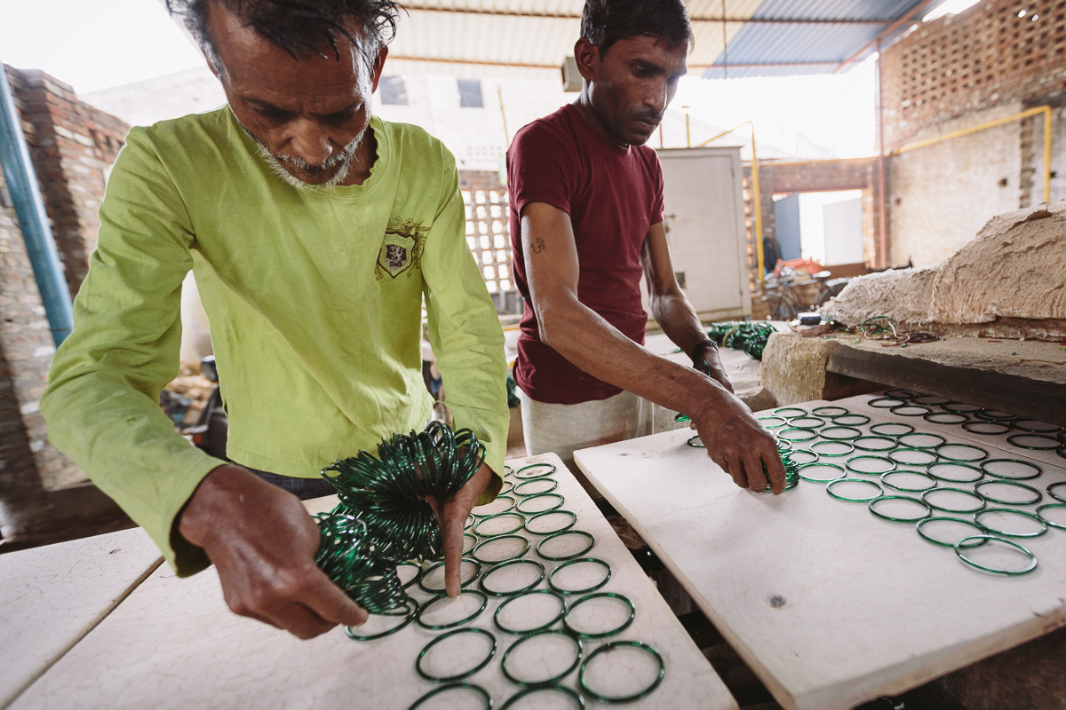 Men work in a glass bangle factory in Firozabad, Uttar Pradesh, India