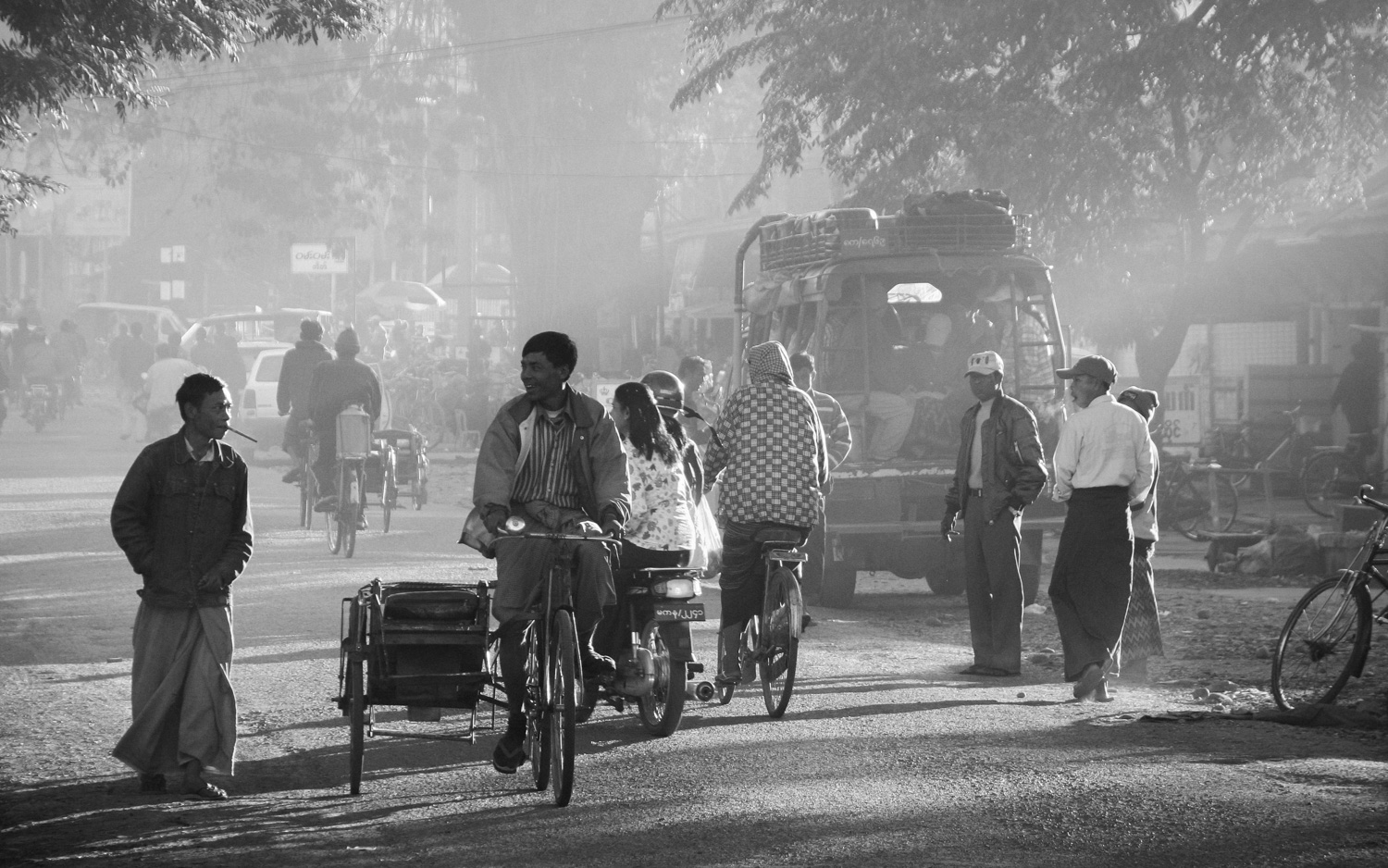 Morning pedestrian, bicycle, and motorbike traffic in Myitkyina, Myanmar, the largest city in Kachin State