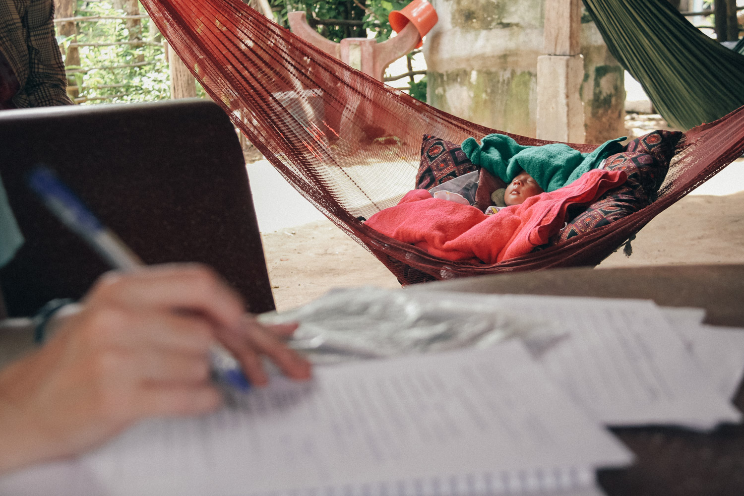A baby sleeps in a hammock at a village home in Siem Reap Province, Cambodia