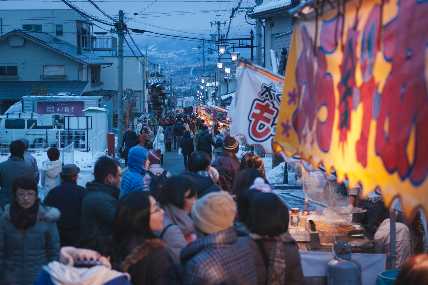 Food vendors line the streets as crowds visit Bessho Onsen, Nagano, Japan during the New Year festival