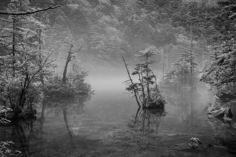 Evening mist settles on Myojin Pond in Kamikochi, Japan