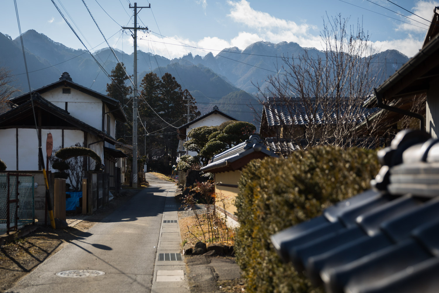 Traditional houses along a quiet rural street near Ueda, Nagano, Japan