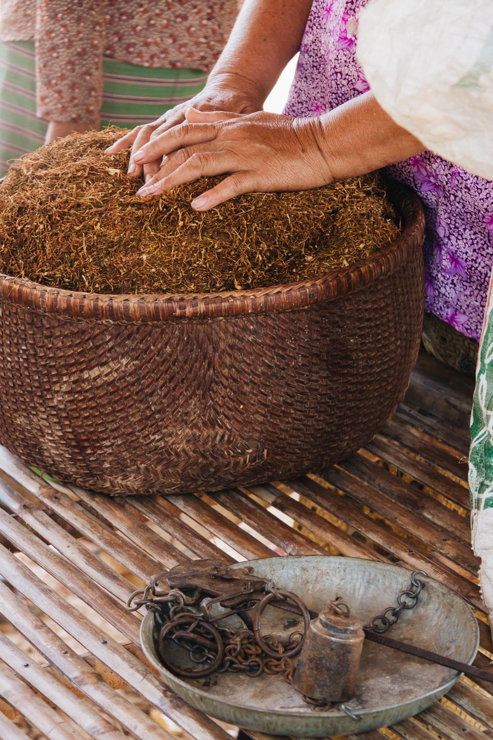 A woman sells her homegrown tobacco in a village in rural Cambodia