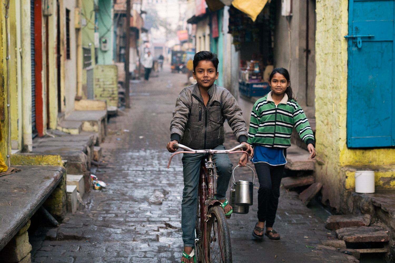 Children run morning errands in Agra, Uttar Pradesh, India